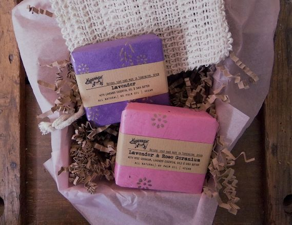 Two large soaps and a soap saver bag. Floral