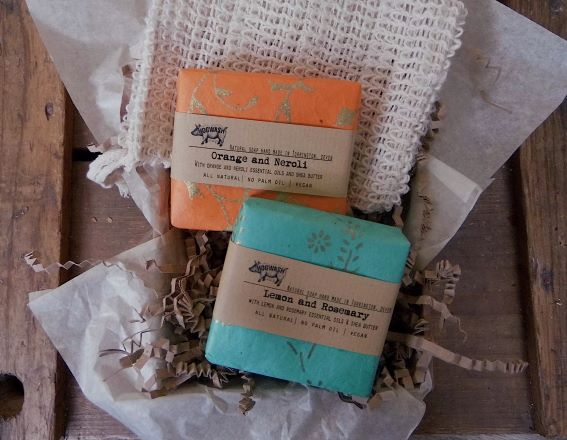 two large soap bars and a sisal soap saver in a gift box. Fruity